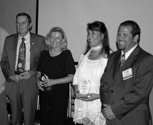 Hall of Fame Induction Ceremony: Bill Pancake; Terri Wallace, accepting on behalf of her Great Aunt Irene Crum, 2015 Inductee; Tracy Miller, accepting on behalf of Angelo Koukoulis, 2015 Inductee; Jerry Brienza